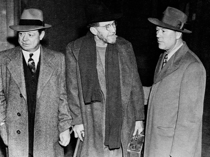 Ezra Pound in the custody of two U.S. Marshals upon his arrival in the USA in 1945.