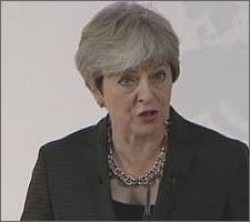 Theresa May in Florence 22.09.2017: grey room, grey background, grey person.
