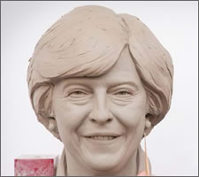 Touching up Mrs May at Madame Tussauds