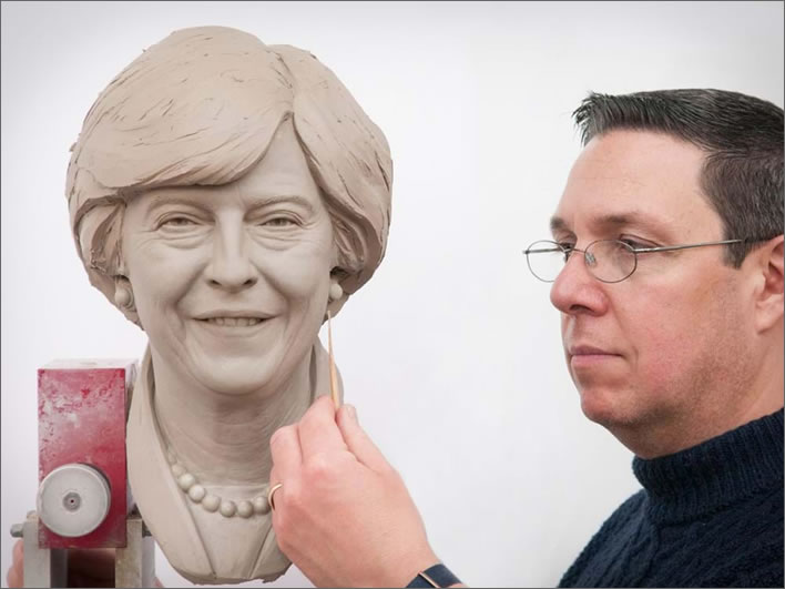 Principal Sculptor Stephen Mansfield with the finished clay head of Theresa May's wax figure.