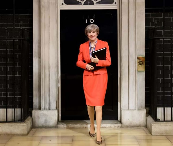 Theresa May's wax figure is seen on the Madame Tussauds London Downing Street set.