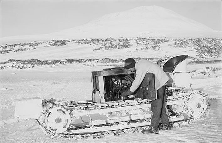 Terra Nova expedition: Bernard Day working on the engine of one of the motor tractors.