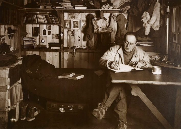 Terra Nova expedition: Captain Scott writing his diary.