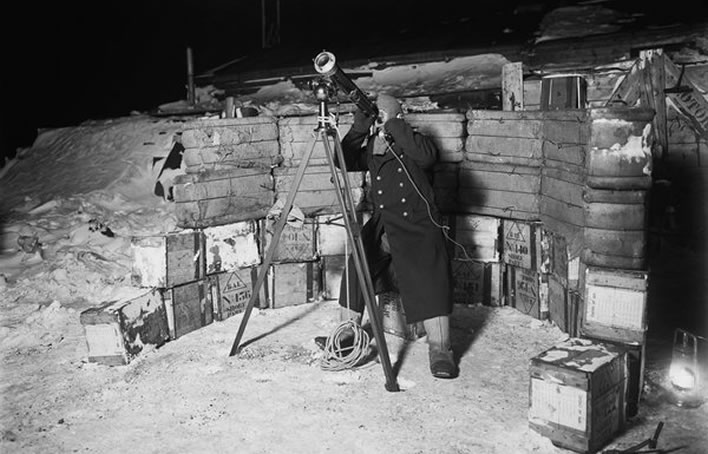 Terra Nova expedition: Teddy Evans looking through a telescope.