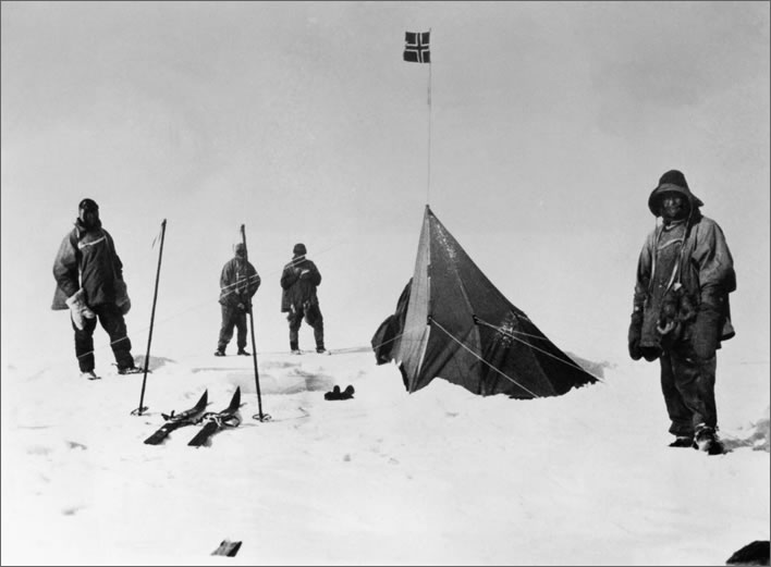 Terra Nova expedition: Four of the Polar Party standing disconsolately around Amundsen's tent.