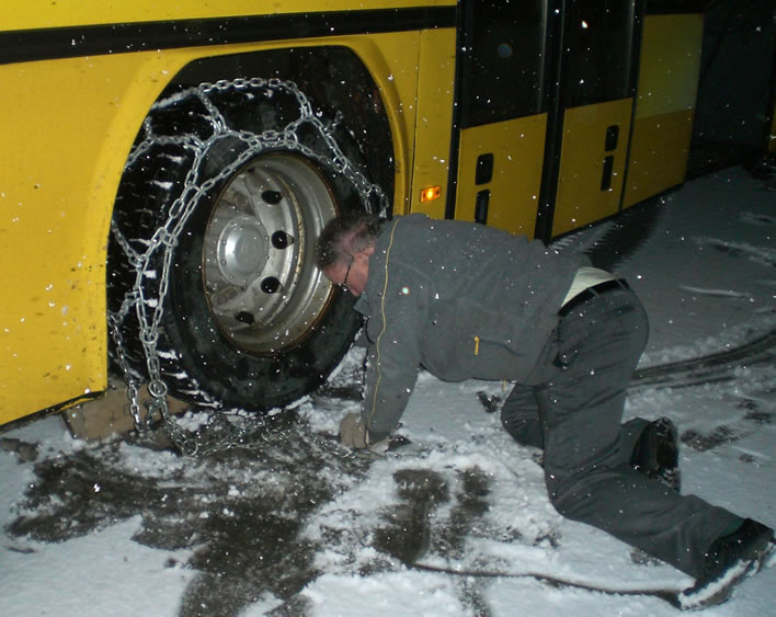 Putting the chains on the PostAuto with the onset of snow.