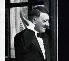 Adolf Hitler in 1937 greeting the crowds from a window in Bayreuth (detail). Image: NZZ/Heritage Images.
