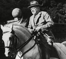 Churchill riding his horse Salve in the grounds of Chartwell, ND (detail).